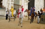 Horses and jockeys enter the track for the rehearsal