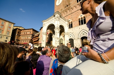 Our spot in the Palio crowd - just next to the rail. Freak it was hot