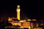 Siena's tower at night