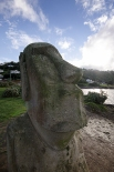 An Easter Island statue gifted by Chile sitting watching Lyall Bay