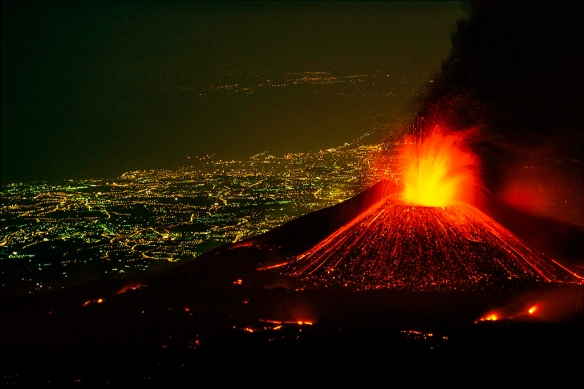 Mt Etna erupting with Catania behind in 2001 - courtesy of photographer Carsten Peter